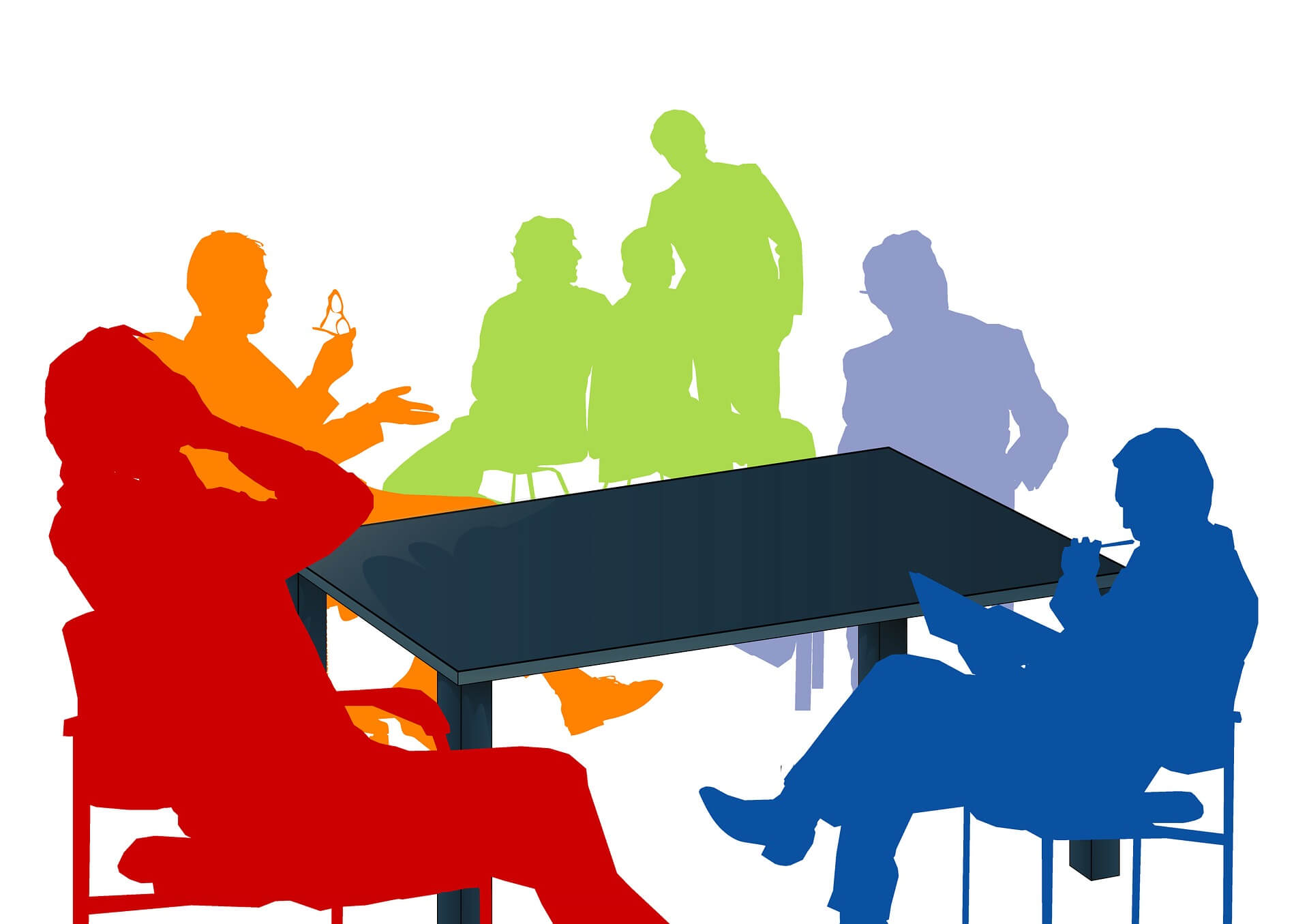 Silhouette of people around a desk
